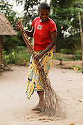 Patience Nsona sweeps the yard outside her home in the village of Kinsiesi, Bas-Congo province, Democratic Republic of Congo on Saturday June 18, 2011.