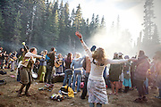 """General prayer. The yearly gathering of the Rainbow Family of Living Light took place in the  Gifford Pinchot National Forest, in the Washington State, near Portland...Rainbow Gatherings are temporary intentional communities, typically held in outdoor settings, and espousing and practicing ideals of peace, love, harmony, freedom and community, as a consciously expressed alternative to mainstream popular culture, consumerism, capitalism and mass media. These gatherings are an expression of a Utopian impulse, combined with bohemianism, hipster and hippie culture, with roots clearly traceable to the 1960s' counterculture. ..A 4-weeks road trip across the USA, from New York to San Francisco, on the steps of Jack Kerouac's famous book """"On the Road"""".  Focusing on nomadic America: people that live on the move across the US, out of ideology or for work reasons."""