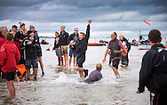 A spectator takes a catch without spilling his glass of wine during the annual Bramble Bank cricket match in the middle of the sea. The eccentric game involves members of the Royal Southern Yacht Club in Hamble playing against the Island Sailing Club from Cowes on the Brambles, a patch of sand in the Solent, only visible for a few minutes on the spring tide. The teams take turns in winning. This year the Royal Southern team won and hosted dinner at their club house.<br /> Picture date Monday 31st August, 2015.<br /> Picture by Christopher Ison. Contact +447544 044177 chris@christopherison.com