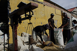 May 6, 2017 - Bekasi Regency, West Java, Indonesia - Farmers pack the rice grain into sacks before being brought to the milling, after harvest in Sukatani village, Bekasi regency, West Java. According to the Ministry of Commerce of the Republic of Indonesia, the stock of food, especially rice, is sufficient to face the holy month of Ramadhan and Eid Al-Fitr 2017 as much as 2.1 million tons. (Credit Image: © Tubagus Aditya Irawan/Pacific Press via ZUMA Wire)