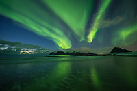 Reflection of Northern Lights - Aurora Borealis on Storsandnes beach, Flakstadøy, Lofoten Islands, Norway
