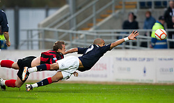 Queen of the South's Mark Campbell brings down Falkirk's Farid El Alagui for a penalty..Falkirk 1 v 0 Queen of the South, 15/10/2011..Pic © Michael Schofield.
