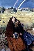 The Blind Girl'. 1856: Two beggar girls, the elder one blind and with concertina she uses for begging in her lap, rest by wayside stream after rain Double rain bow in background. Forget-me-nots bloom bottom left. Butterfly settles on girl's cloak.   John Everett Millais (1829-1896) English artist.  Pre-Raphaelite Brotherhood. Oil on canvas.