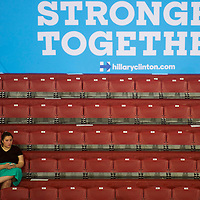 PHILADELPHIA, PA- July 29, 2016.  A woman arrives first in a bleacher section underneath a campaign sign before Hillary Clinton and Tim Kaine held a rally the day after the Democratic National Convention at Temple University in Philadelphia, PA on July 29, 2016.  CREDIT: Mark Makela for The New York Times      NYTDNC