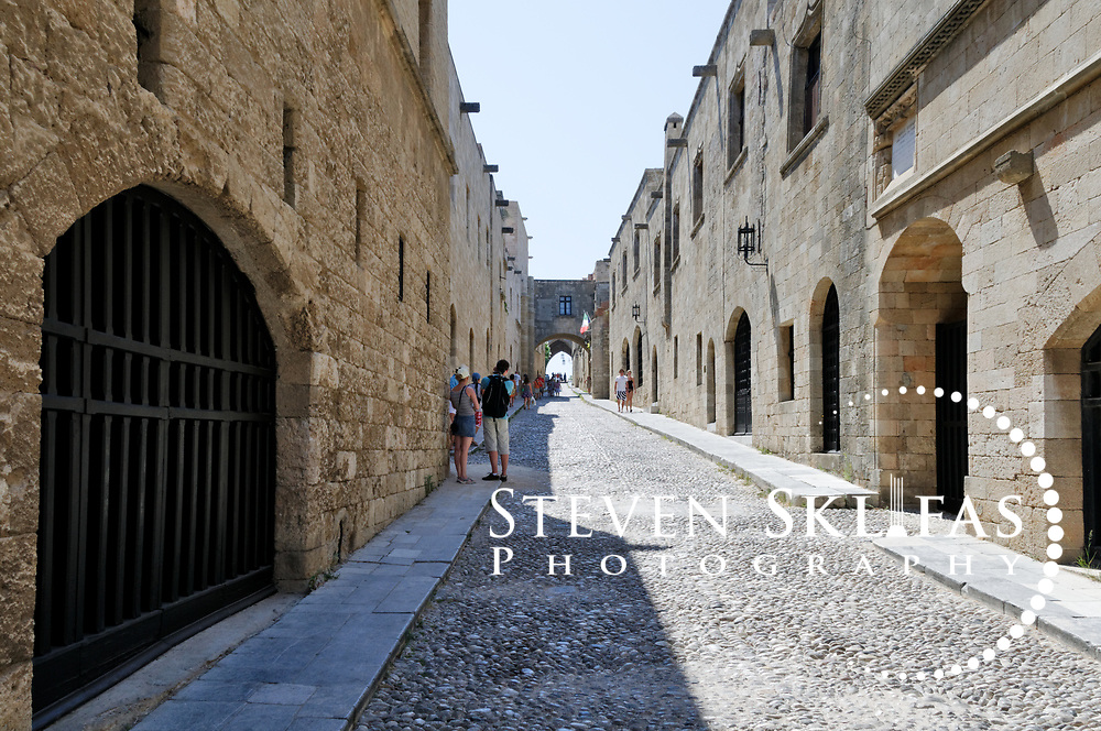 Rhodes. Greece. The Street of the Knights which is the perhaps the best preserved medieval street in Europe. The street is lined by the Inns of the Tongues (or nationalities) of the Order of St John and is located inside the old walled town of Rhodes which is a UNESCO world heritage listed site and the best preserved, oldest and largest living medieval city in Europe. The 4km defensive walls were built by the Knights of St John during the 13th to 15th century to defend Western Europe against the expanding Ottoman Empire. Within the walls are a medieval warren of small alleyways and magnificent historical buildings. The island of Rhodes is the largest of the Dodecanese Island group and one of the most popular Greek Islands.