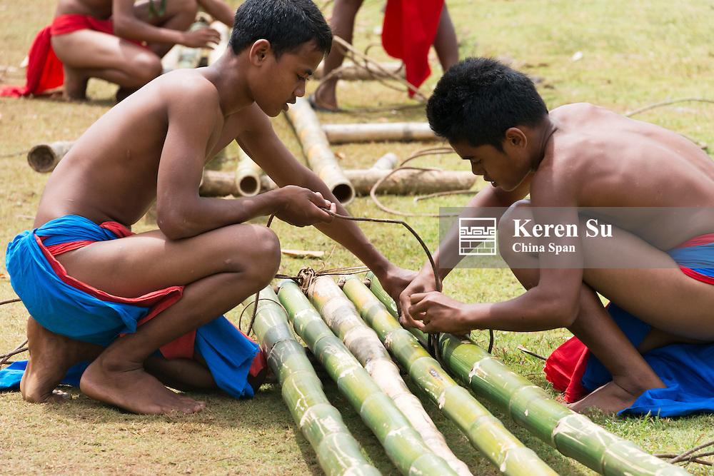 Yapese boys making bamboo canoe, Yap Island, Federated States of Micronesia