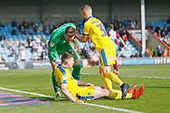 Scunthorpe United goalkeeper Jak Alnwick (25) accuses Wimbledon midfielder Steve Seddon (15)  of diving following the award of a penalty during the EFL Sky Bet League 1 match between Scunthorpe United and AFC Wimbledon at Glanford Park, Scunthorpe, England on 30 March 2019.