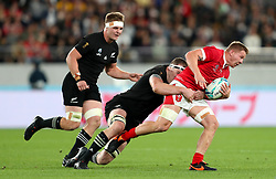 Wales' James Davis is tackled by New Zealand's Brodie Retallick during the 2019 Rugby World Cup bronze final match at Tokyo Stadium.