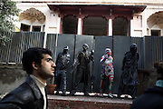 At the national college of art in Lahore a student walks past sculptures by Ghafar Afridi, a student from Peshawar in north Pakistan.