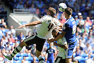 Cardiff city's Alex Revell beats Fulham's Shaun Hutchinson (4) to a header. Skybet football league championship match, Cardiff city v Fulham at the Cardiff city stadium in Cardiff, South Wales on Saturday 8th August  2015.<br /> pic by Carl Robertson, Andrew Orchard sports photography.