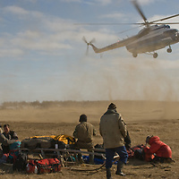 North of the Arctic Circle in Russia, a helicopter lands at Snopa village to ferry passengers back to the nearest big city, Arkhangel'sk.