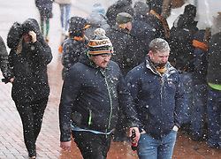Fans make their way through a Snow shower to Molineux Stadium ahead of the Sky Bet Championship match between Wolverhampton Wanderers and Burton Albion.