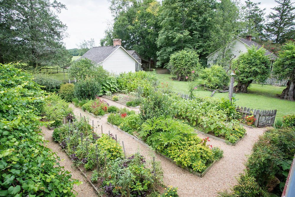 From the top floor galley of Maison Chenal is a view of the the French kitchen garden or potager, a garden intermingled vegetables, fruits, flowers, and herbs.