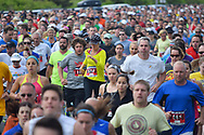 Spring Lake, NJ 07762 - May 24, 2014. Runners bunched up at the beginning of the annual Spring Lake 5k race. Editorial Use Only.