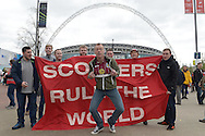 an Aston Villa fan invades a group of Liverpool fans cheering outside Wembley Stadium before k/o. The FA Cup, semi final match, Aston Villa v Liverpool at Wembley Stadium in London on Sunday 19th April 2015.<br /> pic by John Patrick Fletcher, Andrew Orchard sports photography.