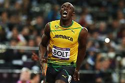 Olympics - London 2012 Olympic Games - 5/8/12.Athletics - Men's 100m Final - Jamaica's Usain Bolt celebrates after winning the race to get gold.© pixathlon