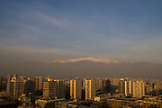 The view from Cerro Santa Lucia, Santiago, Chile of downtown Santiago, the smog, and the Andes Mountains.