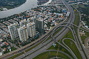 aerial view of highway with loops, urban and river view in District 2 Ho Chi Minh City, Vietnam