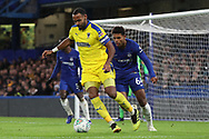 AFC Wimbledon midfielder Liam Trotter (14) screening the ball from Faustino Anjorin of Chelsea (64) during the EFL Trophy match between U21 Chelsea and AFC Wimbledon at Stamford Bridge, London, England on 4 December 2018.