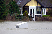 © Licensed to London News Pictures. 11/02/2014. Laleham, UK. A fridge floats down the flooded Thames.  Flooding in LALEHAM in Surrey today 11th February 2014 after the River Thames burst its banks. The Environment Agency has issued 14 Severe Flood Warnings alone the Thames. Photo credit : Stephen Simpson/LNP