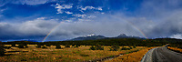 Rainbow, Sky, Clouds and Mountains in Torres del Paine National Park. In-camera panorama taken with a Fuji X-T1 camera.