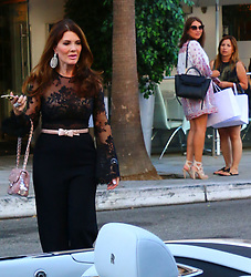 RHOBH's Lisa Vanderpump and Ken Todd cross street in front of one of their restaurants while filming new episode. 13 Jul 2017 Pictured: Lisa Vanderpump and Ken Todd. Photo credit: KAT / MEGA TheMegaAgency.com +1 888 505 6342