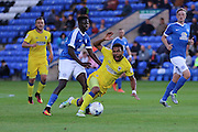 AFC Wimbledon striker Andy Barcham (17) and Peterborough United midfielder Leo Da-Silva-Lopes (18) tussle during the EFL Cup match between Peterborough United and AFC Wimbledon at ABAX Stadium, Peterborough, England on 9 August 2016. Photo by Stuart Butcher.