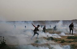 March 30, 2019 - Al-Buraj Refugee Camp, Gaza Strip - Thousands of Palestinians gathered east of Al-Buraj refugee camp in the middle of the Gaza strip, a mass demonstration to mark the one-year anniversary of the 'Great march of Return', 3 Palestinian were killed 300 people injured after Israeli troops use live fire to break up the protest. (Credit Image: © Mahmoud Khattab/Quds Net News via ZUMA Wire)