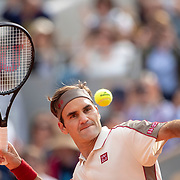 PARIS, FRANCE May 29.   Roger Federer of Switzerland celebrates his victory against Oscar Otte of Germany by hitting the ball into the spectators on Court Philippe-Chatrier in the Men's Singles second round match at the 2019 French Open Tennis Tournament at Roland Garros on May 29th 2019 in Paris, France. (Photo by Tim Clayton/Corbis via Getty Images)