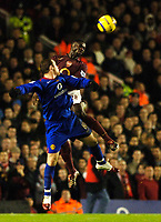Photo: Daniel Hambury.<br />Arsenal v Manchester United. The Barclays Premiership.<br />03/01/2006.<br />Arsenal's Kolo Toure clears from United's Wayne Rooney.