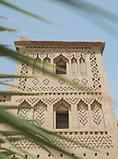 Details on the facade of a mud built kasbah hotel in the Skoura Oasis in Morocco