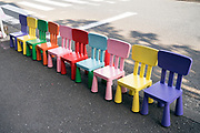 a row with brightly colored children chairs