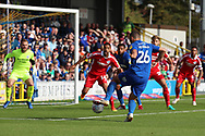 AFC Wimbledon defender Rod McDonald (26) with a shot on goal during the EFL Sky Bet League 1 match between AFC Wimbledon and Scunthorpe United at the Cherry Red Records Stadium, Kingston, England on 15 September 2018.