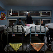Afghan National Police (ANP) cadets tide their beds in the early hours of the morning at the Afghan Nacional Police Academy in Kabul.
