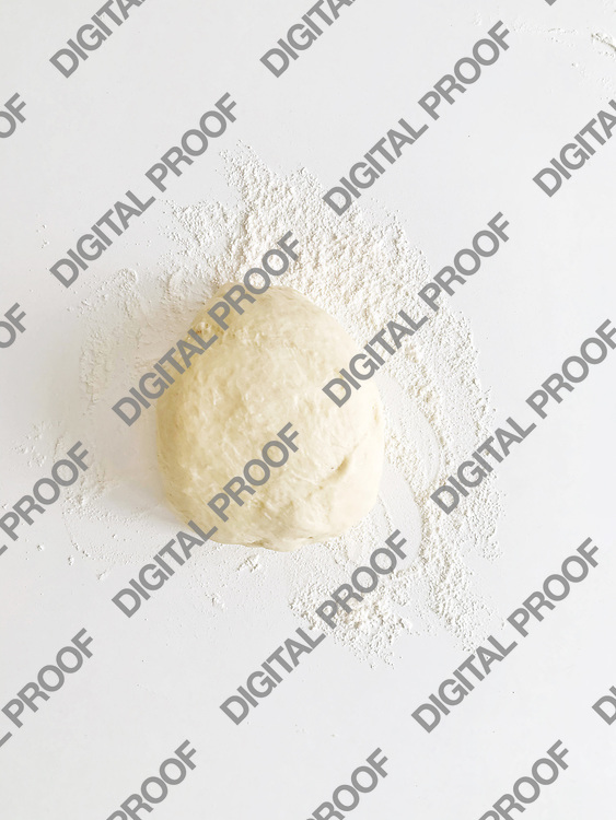 Bun of wheat flour over a white table ready for cooking