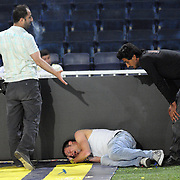 Fenerbahce supportes supporters cry on the pitch after Turkish Super League soccer match between Fenerbahce and Trabzonspor at Sukru Saracoglu Stadium in Istanbul, Turkey, 16 May 2010. Fenerbahce lost the Championship after a draw with Trabzonspor. Photo by TURKPIX