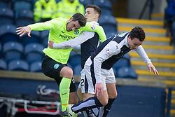 Hibernian's Brian Graham held by Raith Rovers Ross Matthews. Raith Rovers 1 v 1 Hibernian, Scottish Championship game played 18/2/2017 at Starks Park.
