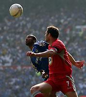 Photo: Paul Thomas.<br /> Blackburn Rovers v Chelsea. The FA Cup, Semi Final. 15/04/2007.<br /> <br /> Brett Emerton of Blackburn tries to stop Ashley Cole (Blue) of Chelsea.