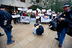 25 February 2013. New Orleans, Louisiana,  USA. .BP Trial. Protesters and the media gather outside the Hale Boggs Federal Courthouse in the early morning drizzle for the opening day of the BP trail  at the New Orleans Federal Courthouse..Photo; Charlie Varley.