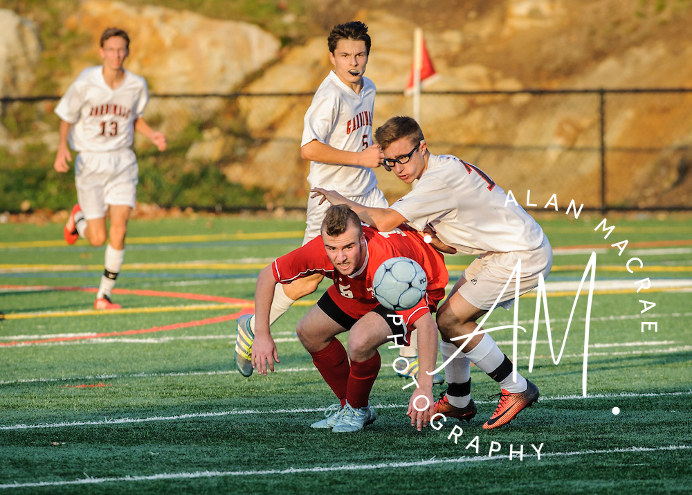 Belmont's Ryan Gelinas watches the ball after heading it to a team mate in the NHIAA Division III semi-final game at Laconia on Wednesday, November 2, 2016.  (Alan MacRae/for the Laconia Daily Sun)