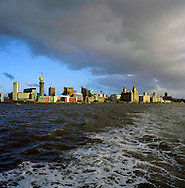 The wake of a ferry crossing the river Mersey from Liverpool's Pier Head en route to Woodside, Wirral. The Mersey is a river in north west England which stretches for 70 miles (112 km) from Stockport, Greater Manchester, ending at Liverpool Bay, Merseyside. For centuries, it formed part of the ancient county divide between Lancashire and Cheshire.