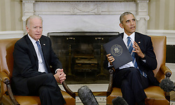 """File photo dated October 17, 2016 of President Barack Obama speaks as Vice President Joe Biden looks on while discussing the release of the Cancer Moonshot Report in the Oval Office of the White House in Washington, DC, USA. Former President Barack Obama endorsed Joe Biden, his two-term vice president, on Tuesday morning in the race for the White House. """"Choosing Joe to be my vice president was one of the best decisions I ever made, and he became a close friend. And I believe Joe has all the qualities we need in a president right now,"""" Obama said in a video posted to Twitter. Photo by Olivier Douliery/ABACAPRESS.COM"""