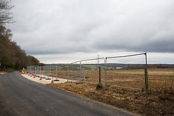 Great Missenden, UK. 9th April, 2021. A field opposite a fenced area on Leather Lane where several hundred-year-old oak trees have been felled to enable the construction of a temporary access road and compound for the HS2 high-speed rail link. Following pressure from local residents (over 40,000 people signed a petition to save the trees), Buckinghamshire Council and the Chilterns Conservation Board, it appears that HS2's plans have been changed in such a way as to preserve some of the trees along the wildlife-rich ancient country lane.
