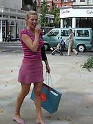 Outside the fashion tents, Sloane Sq. 1p.m. 21/9/03© Copyright Photograph by Dafydd Jones 66 Stockwell Park Rd. London SW9 0DA Tel 020 7733 0108 www.dafjones.com