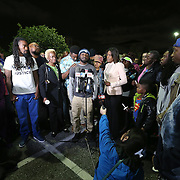 Johnny, the son of deceased Orlando Police officer Master Sgt. Debra Clayton, speaks about his mother during her vigil at an Orlando Walmart, on January 10, 2017 in Orlando, Florida. Orange County deputy Norm Lewis who was also killed on his motor patrol while responding to Clayton's shooting was also honored.  (Alex Menendez via AP)