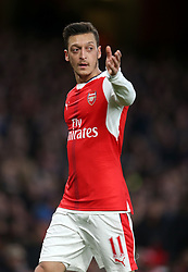 "Arsenal's Mesut Ozil reacts during the Premier League match at the Emirates Stadium, London. PRESS ASSOCIATION Photo. Picture date: Wednesday April 26, 2017. See PA story SOCCER Arsenal. Photo credit should read: Steven Paston/PA Wire. RESTRICTIONS: EDITORIAL USE ONLY No use with unauthorised audio, video, data, fixture lists, club/league logos or ""live"" services. Online in-match use limited to 75 images, no video emulation. No use in betting, games or single club/league/player publications"