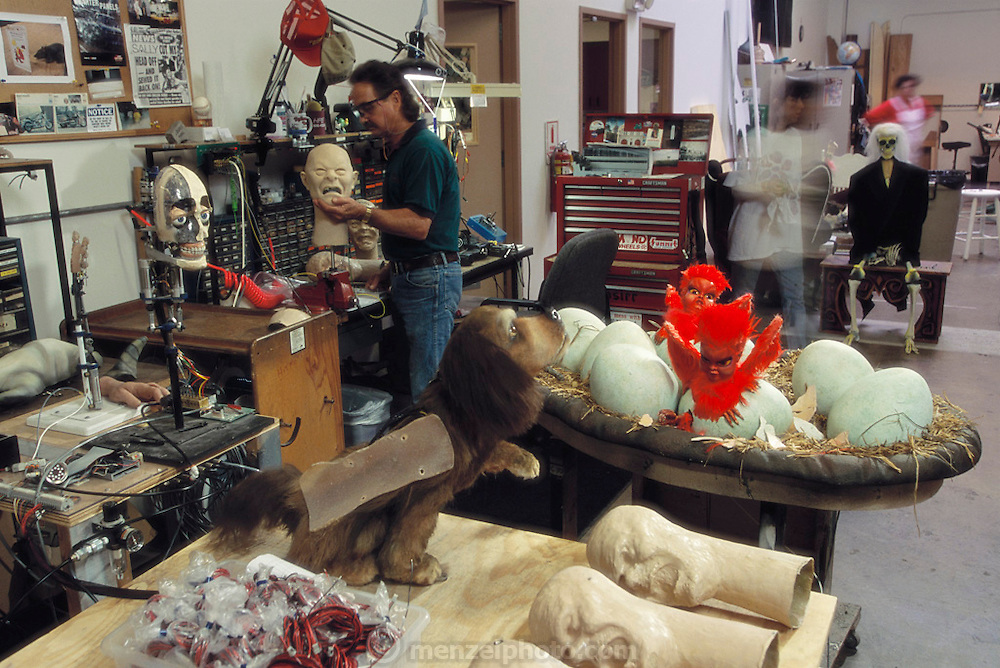 At the Sally Corporation in Jacksonville, Florida, technicians and artists work on robots for theme parks: heads, dogs, hatching monster birds and ghouls.