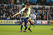 Bournemouth Defender Tyrone Mings (26) battles for possesion with Millwall striker Lee Gregory (9) during the The FA Cup 3rd round match between Millwall and Bournemouth at The Den, London, England on 7 January 2017. Photo by Matthew Redman.
