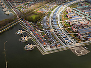 Nederland, Noord-Holland, Gemeente Heerhugowaard, 16-04-2012; verstedelijking van een polder, nieuwbouwwijk 'Stad van de zon', huizen met zonnecollectoren op het dak..Urbanisation of a polder in Heerhugowaard (NW Netherlands)  , new residential areas and urban sprawl. City of the Sun district, houses covered in solar panels..luchtfoto (toeslag), aerial photo (additional fee required);.copyright foto/photo Siebe Swart