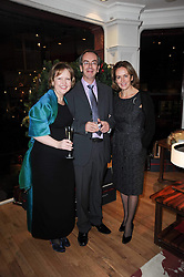 Left to right, HELEN CHISLETT, her husband JOHN ENOCK and CAROLINE MICHEL at the Linley Christmas Party and launch of the book 'Star Pieces' by David Linley, Charles Cator and Helen Chislett held at Linley, 60 Pimlico Road, London on 18th November 2009.